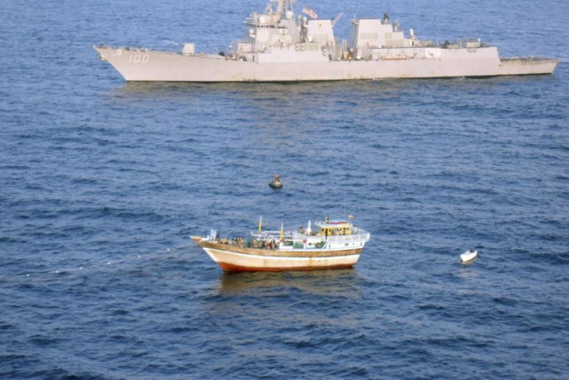 The guided-missile destroyer USS Kidd responds to a distress call from the master of the Iranian-flagged fishing dhow Al Molai, who claimed he was being held captive by pirates in the Arabian Sea