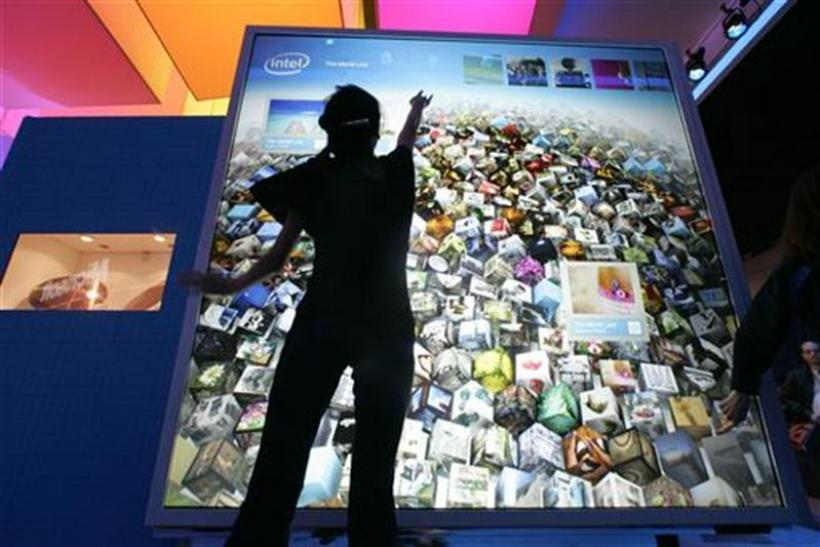 Nguyen interacts with a display at the Intel booth during the 2010 International CES in Las Vegas