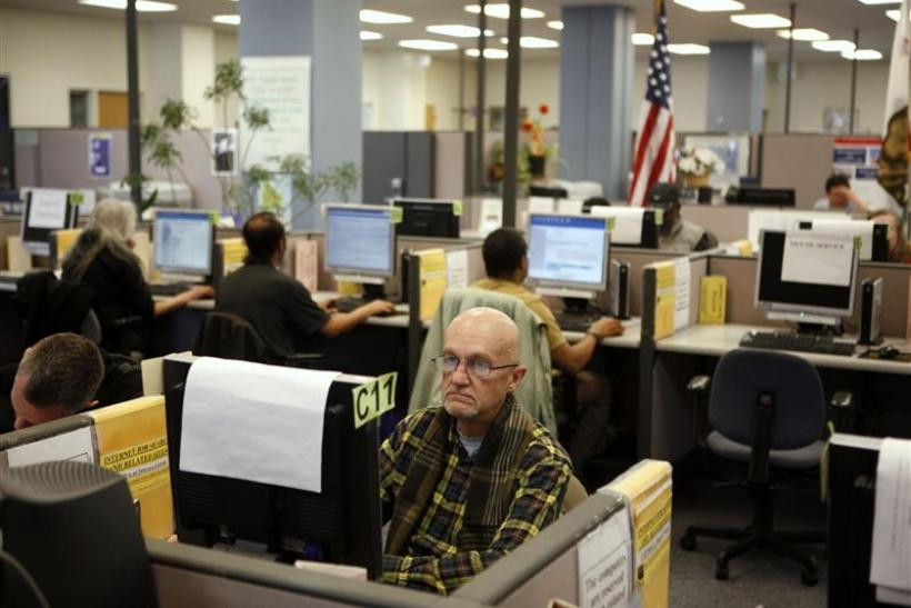 Johnson looks for warehouse work online at the Employment Development Department of California service office in San Francisco