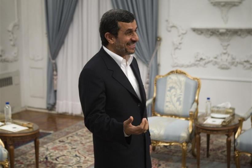 Iranian President Ahmadinejad speaks with Iran's Foreign Minister Salehi in Tehran