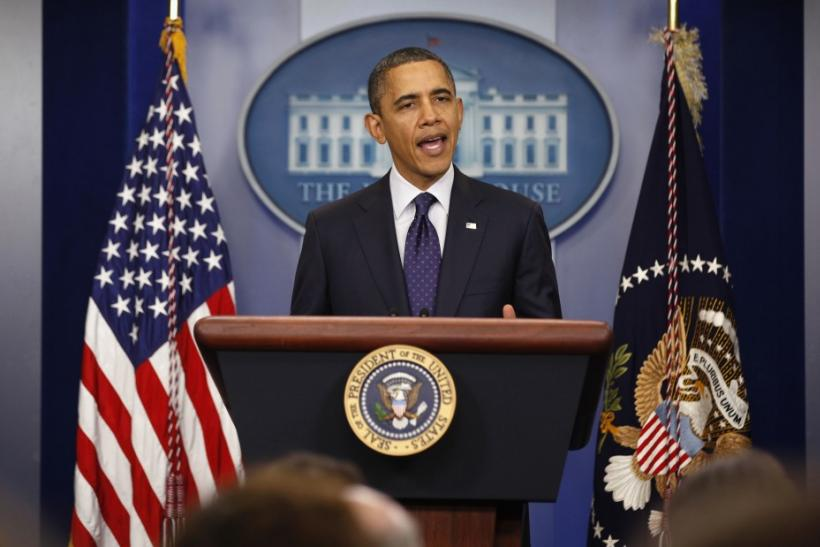 U.S. President Barack Obama speaks to the press after signing into law a two-month payroll tax cut extension at the White House in Washington December 23, 2011.
