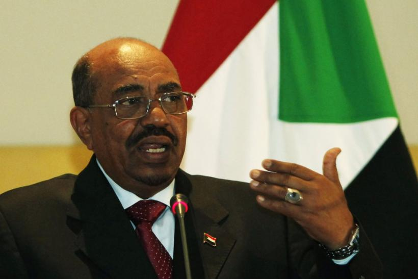 Sudanese President Omar Hassan al-Bashir speaks during a news conference in Tripoli