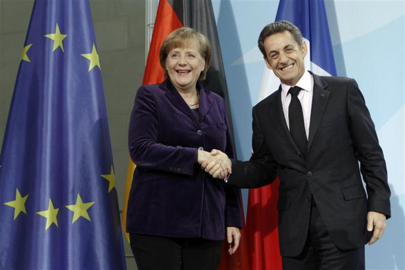 French President Sarkozy and German Chancellor Merkel shake hands after news conference in Berlin