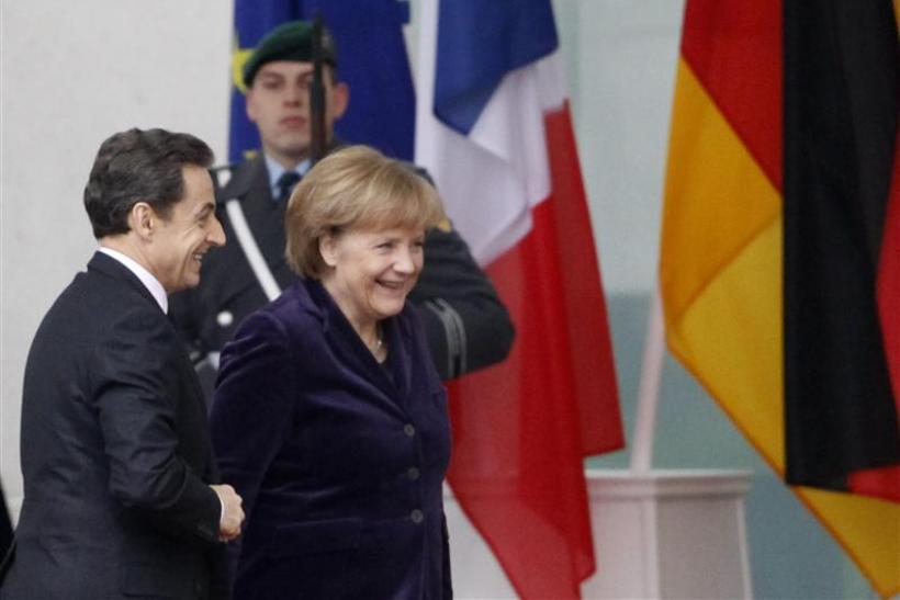 French President Sarkozy arrives to visit German Chancellor Merkel at the Chancellery in Berlin