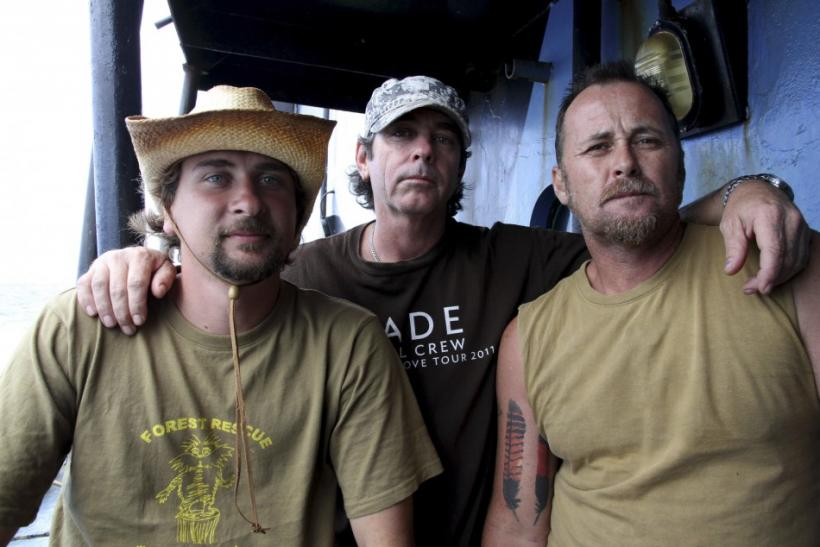 Handout picture shows activists from Forest Rescue posing for a photograph aboard the Sea Shepherd Conservation Society.