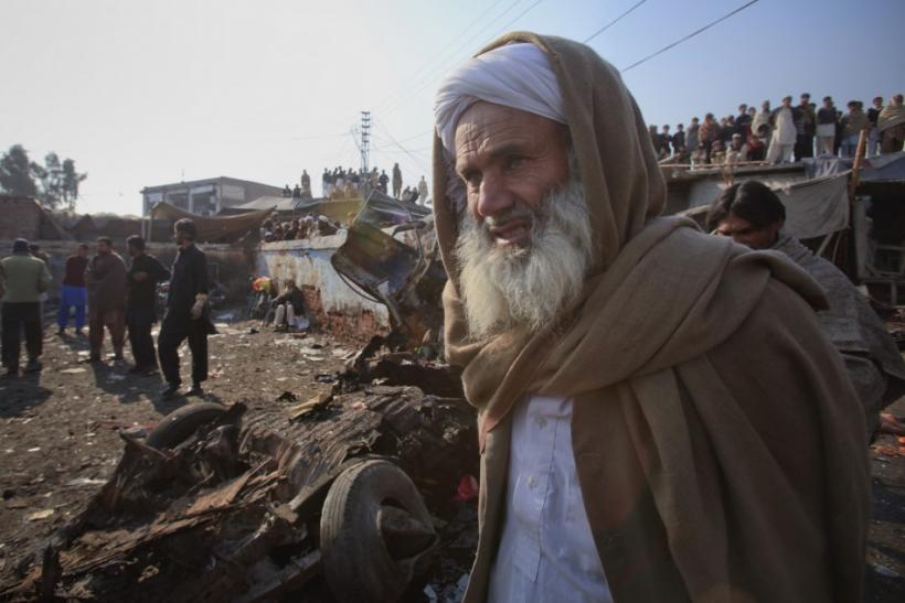 A Pashtun tribesman stands at the site of a bomb explosion in Jamrud bazaar, about 25 km (15 miles) west of Peshawar in northwest Pakistan