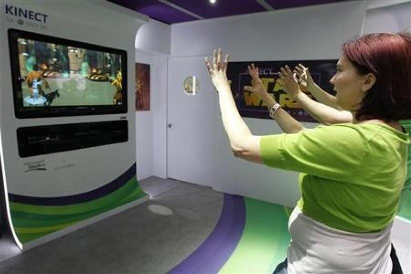Liz Miller of Los Angeles plays Kinect for Star Wars at the Microsoft XBOX 360 booth at E3 in Los Angeles, California June, 7 2011.