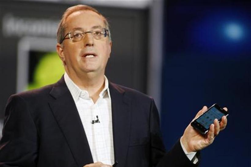 Otellini, president and CEO of Intel Corporation, holds an Intel smartphone reference design as he gives a keynote address during the Consumer Electronics Show in Las Vegas