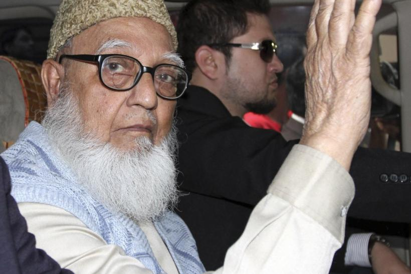 Ghulam Azam, former chief of Jamaat-e-Islami party, waves to the media after a court sent him to jail in Dhaka