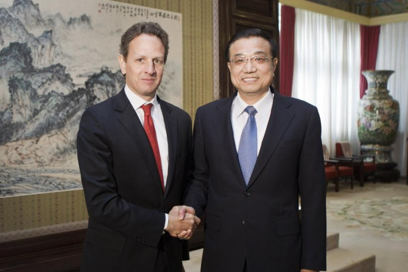 U.S. Treasury Secretary Geithner shakes hands with Chinese Vice Premier Li in Beijing