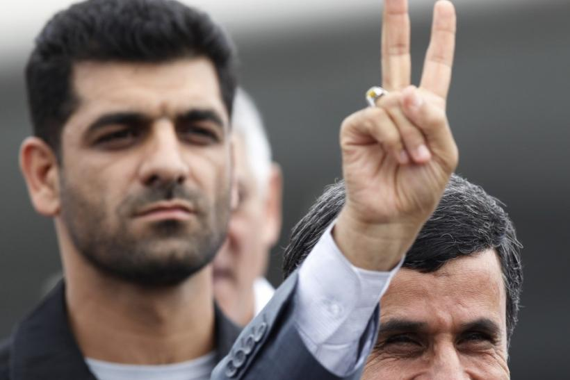 Iran's President Mahmoud Ahmadinejad gestures next to his bodyguard at Havana's Jose Marti airport