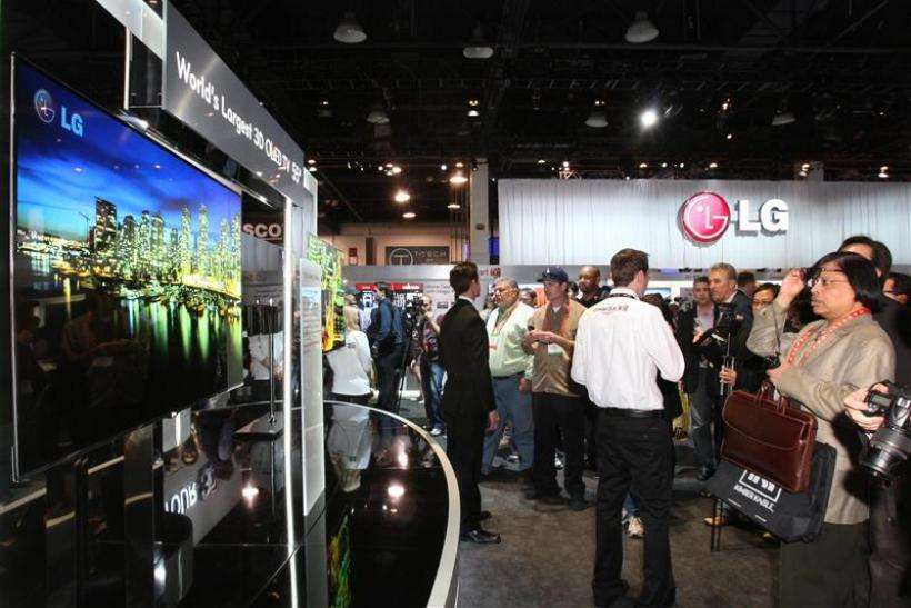 Showgoers look at a display of 55-inch 3D OLED televisions at the LG Electronics booth during the 2012 International Consumer Electronics Show in Las Vegas