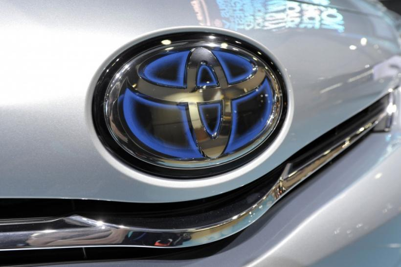The Toyota logo is shown on the front of a Prius Hybrid vehicle during the first press preview day for the North American International Auto Show in Detroit