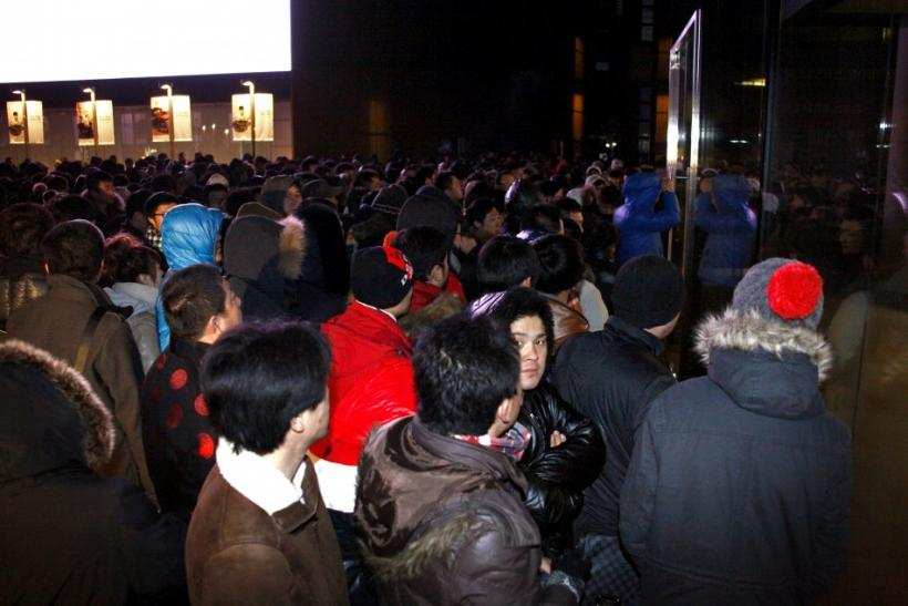 A crowd stands outside an Apple store in Beijing