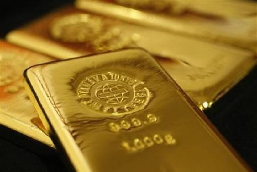Gold eases as euro dips, heads for weekly gain
