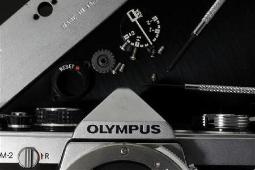 A disassembled Olympus camera and its parts are seen in this illustrative photograph taken in Tokyo, November 24, 2011.