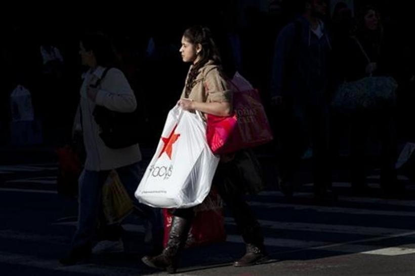 A Black Friday shopper crosses 34th Street outside Macy's in Herald Square in New York
