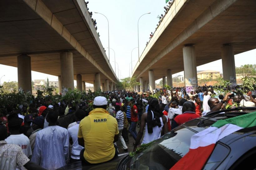 Demonstrators gather during a protest against the elimination of a popular fuel subsidy in Abuja