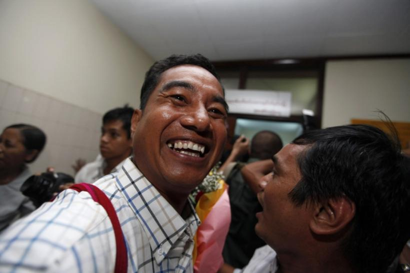 Political prisoner Zaw Thet Htway, released from Taunggyi prison, smiles as he arrives in Yangon domestic airport