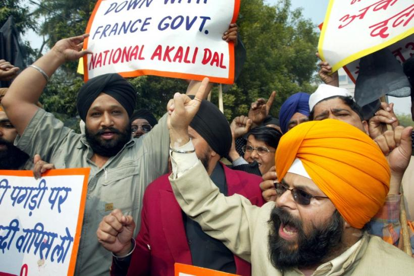 Members of National Akali Dal, a regional Sikh political party, shout anti-French slogans during a protest in New Delhi