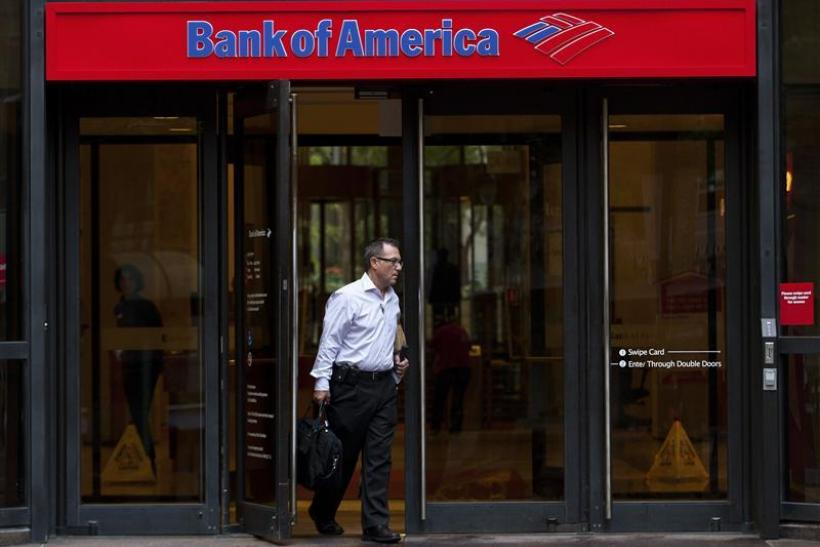 A Bank of America customer leaves a banking branch in Charlotte, North Carolina