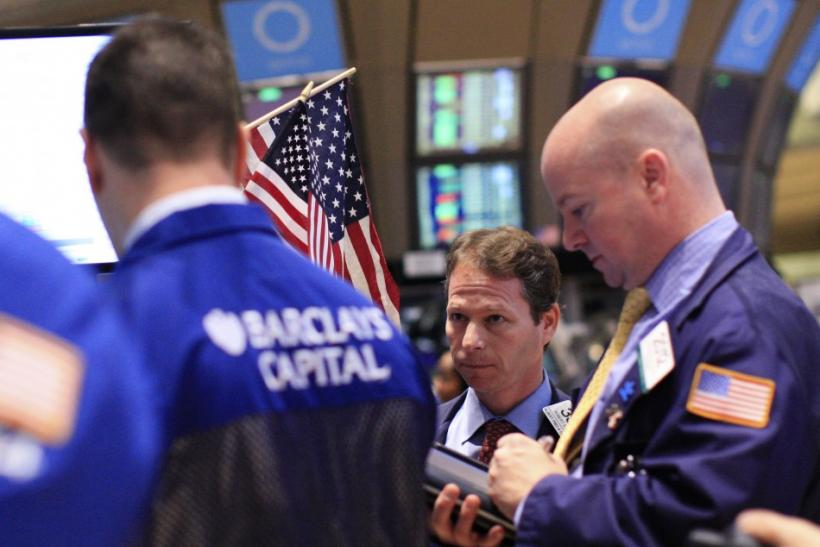 Traders work on the floor of the New York Stock Exchange, January 13, 2012.