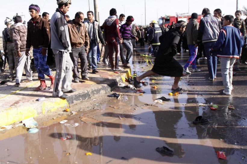 Residents inspect the site of a bomb attack in Basra