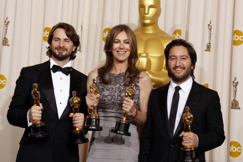"Best motion picture winners Mark Boal, left, Kathryn Bigelow, and Greg Shapiro of the film ""The Hurt Locker,"" display their Oscars at the 82nd Academy Awards in Hollywood, Calif., on March 7, 2010."