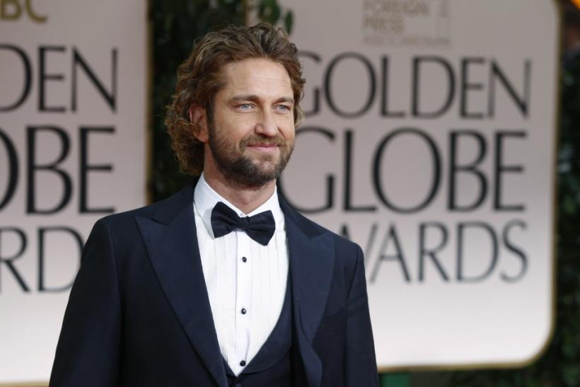 Actor Gerard Butler poses for photographers at the 69th annual Golden Globe Awards in Beverly Hills