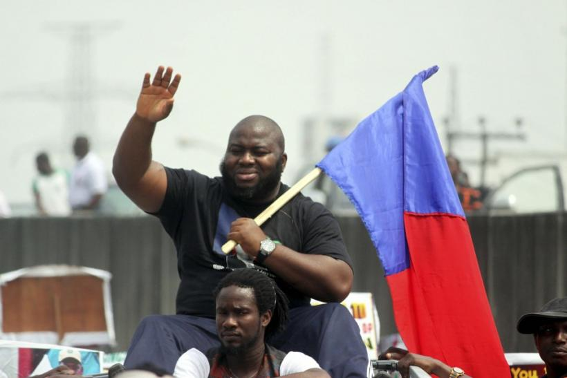 Asari Dokubo, leader of the Niger Delta People Volunteers Force, waves during a march in support of Nigeria's President Goodluck Jonathan on fuel subsidies removal in the oil hub city of Port Hacourt