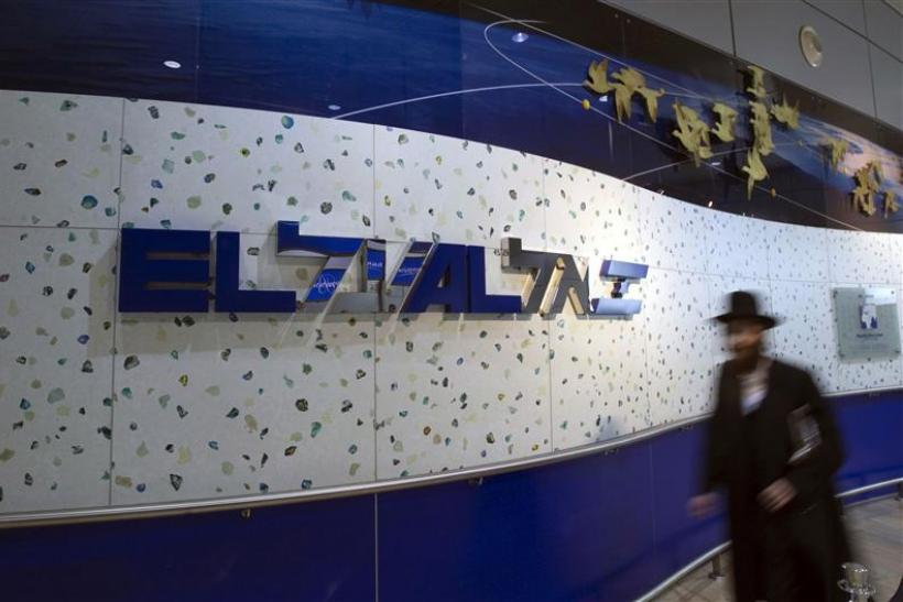 File photo of an ultra-Orthodox Jewish man walking past an El Al Israel Airlines logo at Ben Gurion airport