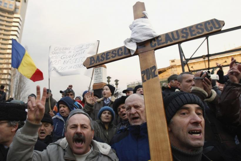 People shout slogans during a protest against Romania's President Basescu at the University Square in Bucharest