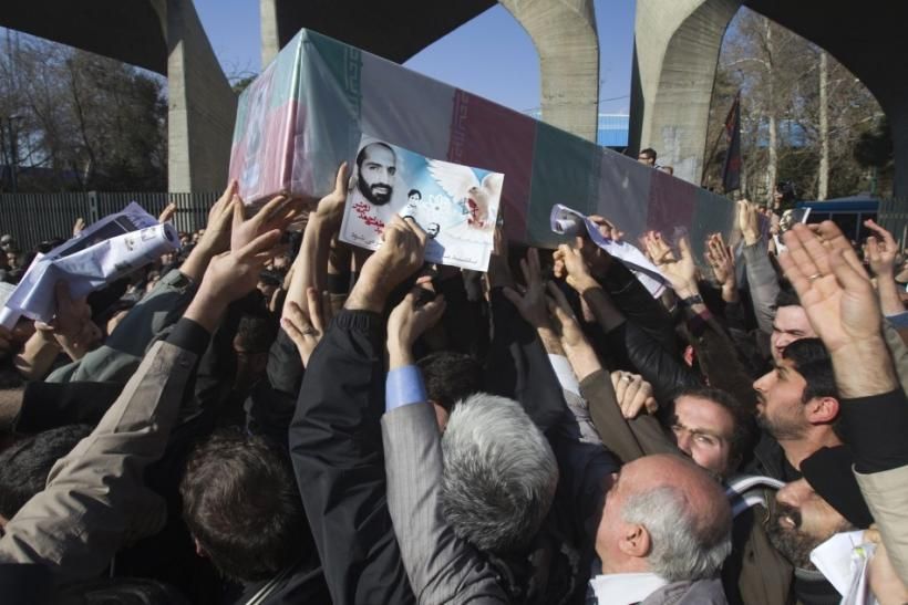 Iranian worshippers carry a picture and coffin of Mostafa Ahmadi-Roshan during his funeral after Friday prayers in Tehran