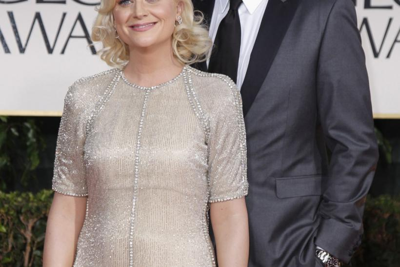 Actress Amy Poehler (L) and her husband, actor Will Arnett, arrive at the 69th annual Golden Globe Awards in Beverly Hills, California January 15, 2012.