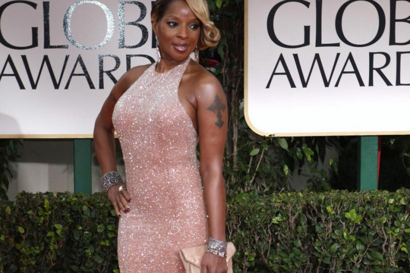 Singer Mary J. Blige poses as she arrives at the 69th annual Golden Globe Awards in Beverly Hills, California January 15, 2012.