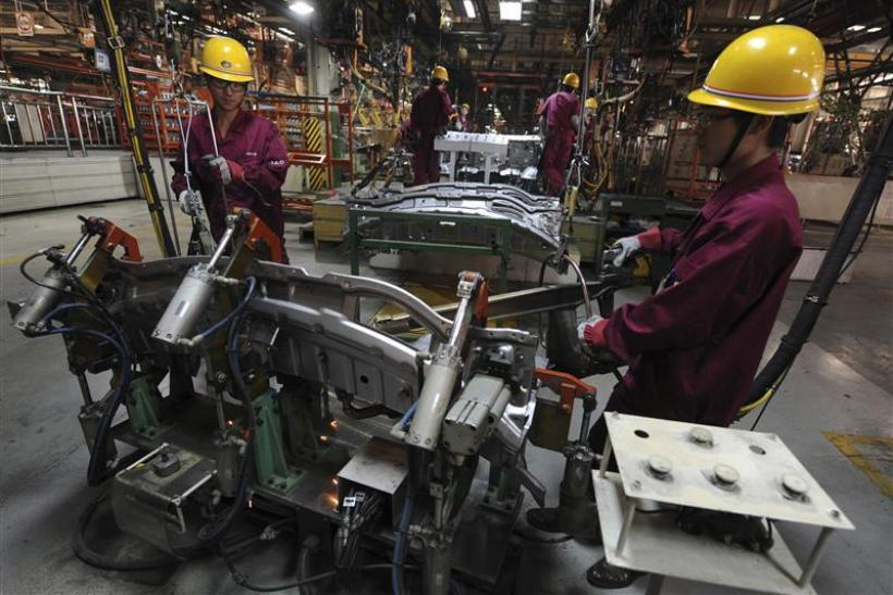 Employees weld automobiles at Anhui Jianghuai Automobile Co. Ltd (JAC Motors) in Hefei