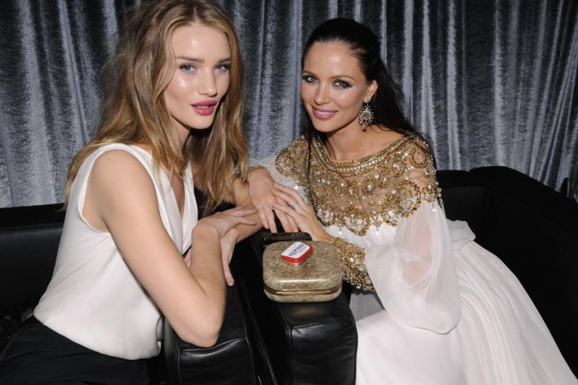 Actress Rosie Huntington-Whiteley (L) and Harvey Weinstein's wife actress Georgina Chapman talk at The Weinstein Company after party following the 69th annual Golden Globe Awards in Beverly Hills, California