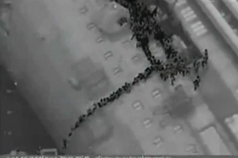 Video grab shows passengers lined up on the side of the Costa Concordia during the evacuation operation
