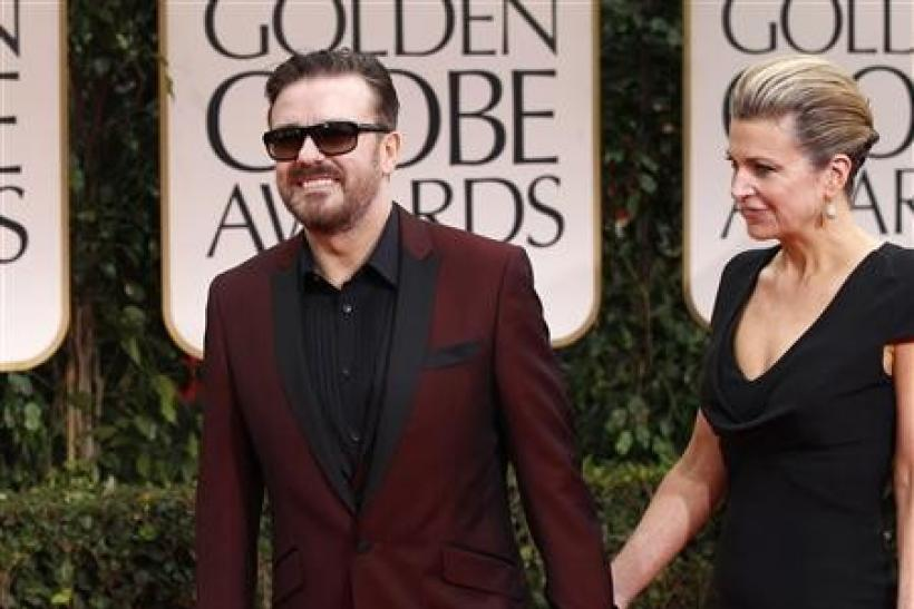 Host Ricky Gervais and partner Jane Fallon arrive at the 69th annual Golden Globe Awards in Beverly Hills, California