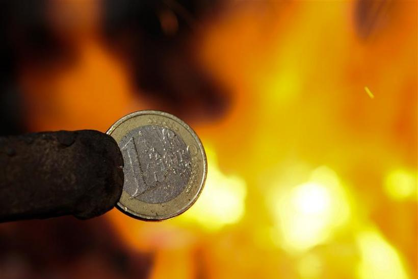 An illustration picture shows a one Euro coin being melted by a smith in Skopje