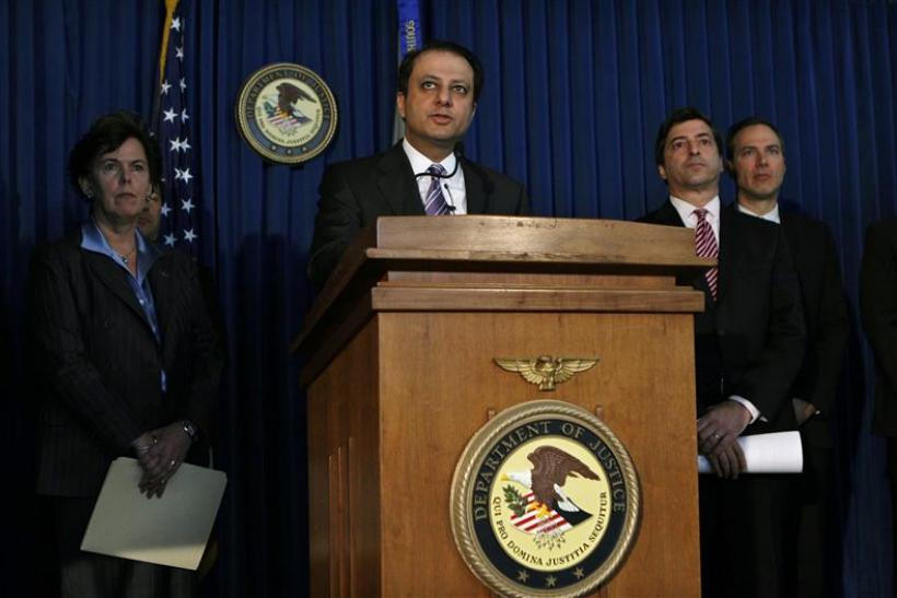 U.S. Attorney Bharara announces charges against seven people during a news conference in New York