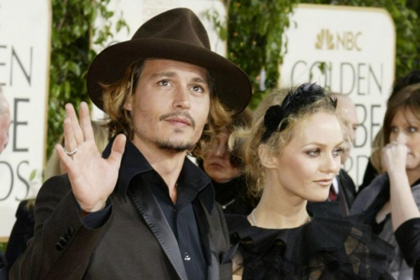 JOHNNY DEPP AND PARTNER AT GOLDEN GLOBES.