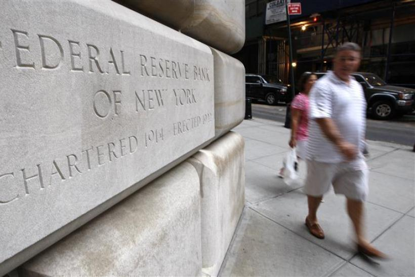 People walk past the Federal Reserve building in New York