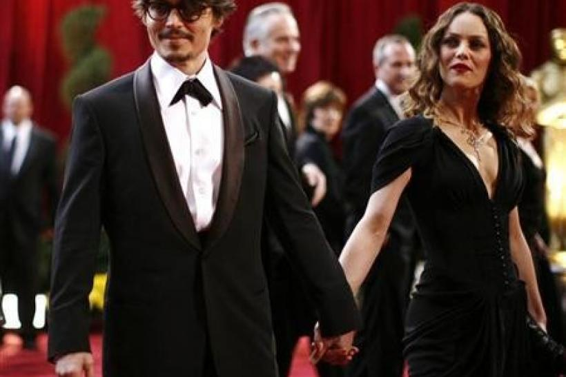 "Johnny Depp, dressed in Giorgio Armani tuxedo and Anto Beverly Hills shirt, best actor Oscar nominee for ""Sweeney Todd The Demon Barber of Fleet Street,"" arrives with his girlfriend Vanessa Paradis, dressed in Chanel and wearing Chanel Fine Jewe"