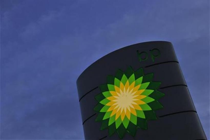 A BP petrol station sign is seen at dawn in west London