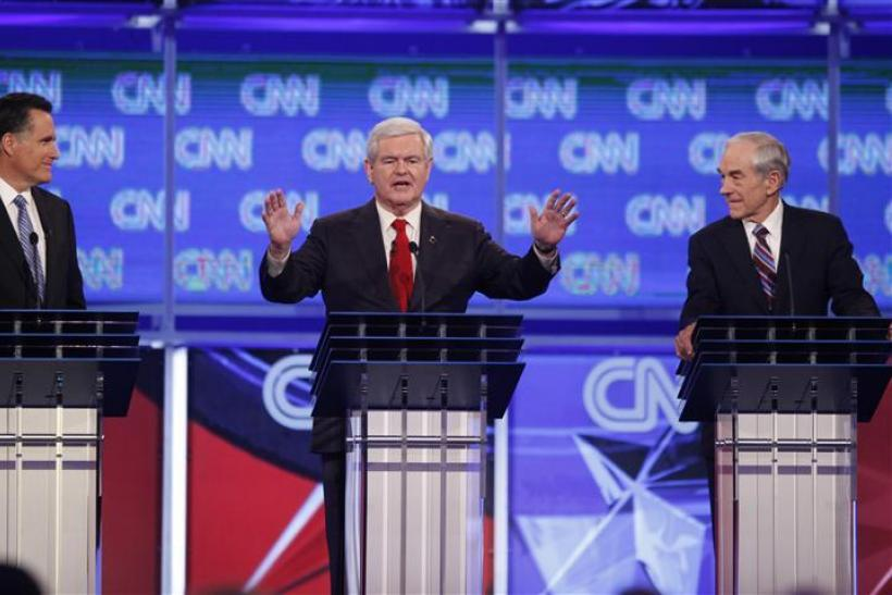 Republican presidential candidate Gingrich speaks as Romney and Paul look on during the Republican presidential candidates debate