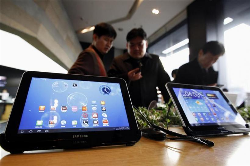 Customers look at Samsung Electronics' Galaxy Tab tablet computers at a store in Seoul