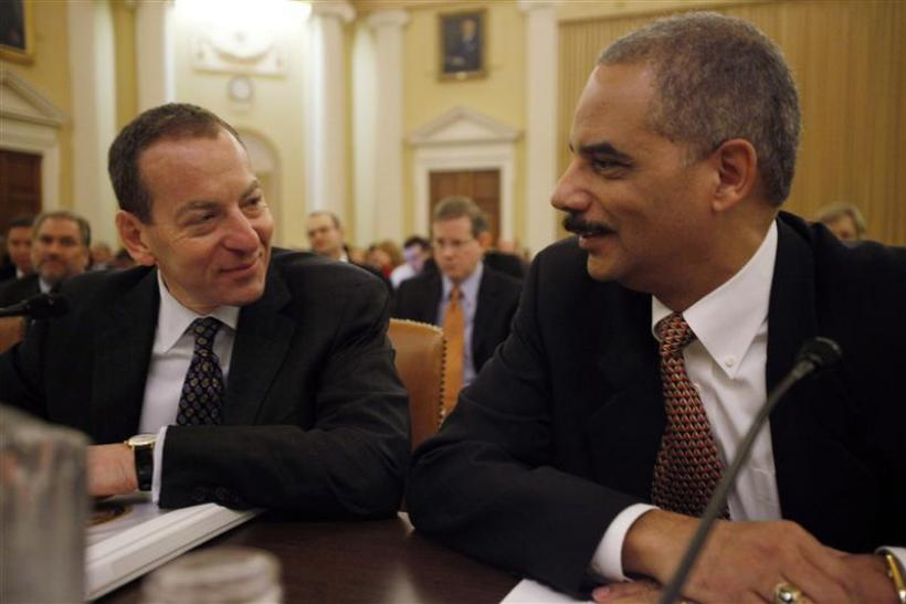 U.S. Attorney General Holder chats with Assistant Attorney General Breuer before their testimony on the second day of the Financial Crisis Inquiry Commission hearing on Capitol Hill in Washington