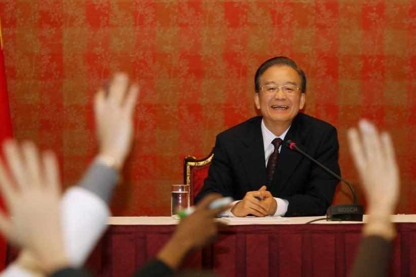 Chinese Premier Wen Jiabao reacts during a news conference in Doha