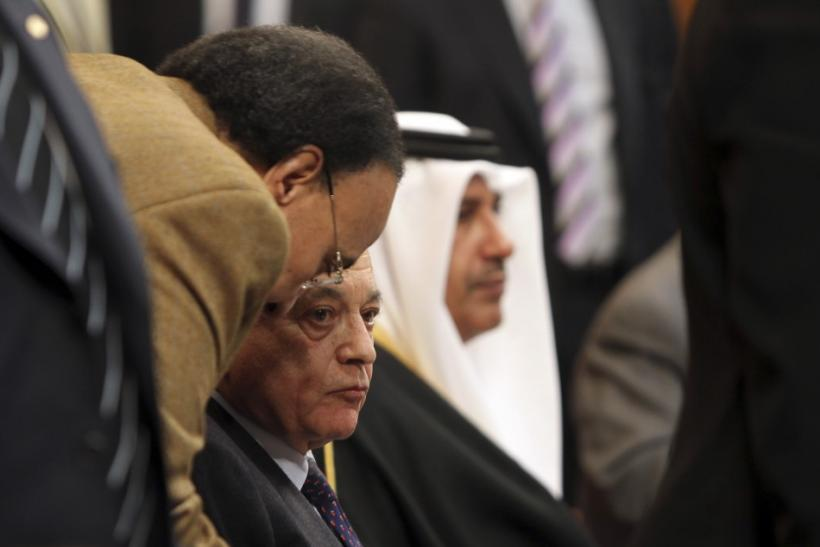 Arab League Secretary General Nabil Elaraby listens to his assistant during the Arab foreign ministers meeting in Cairo